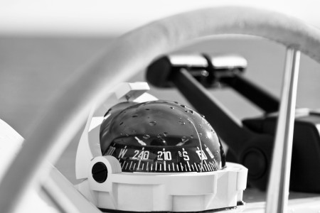 close up of a compass on a boat