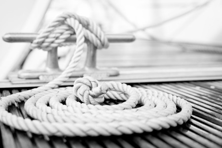 close up of a rope tied to a dock