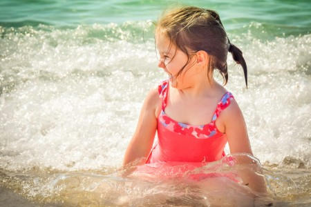 Little Girl Laughing in the Waves