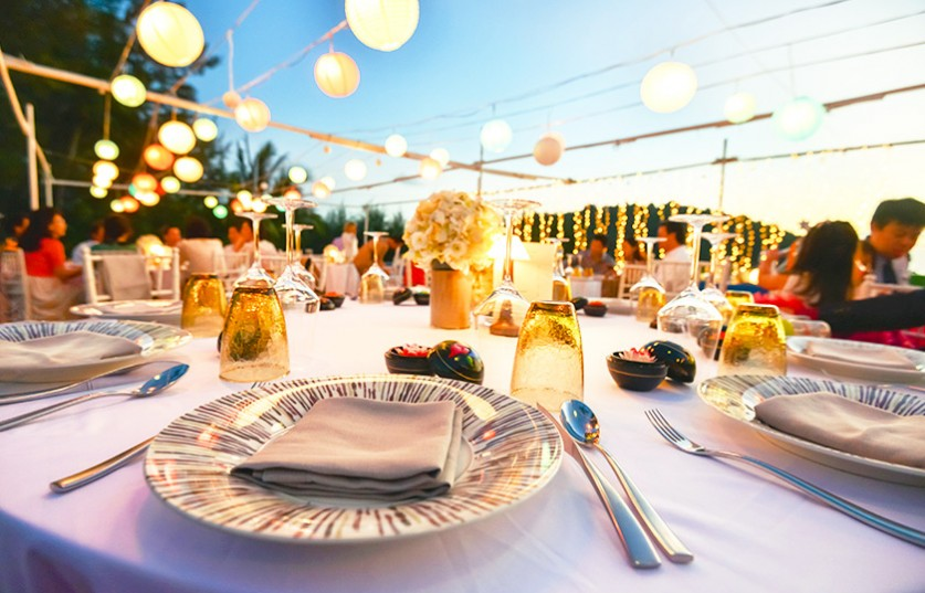 close up of dining table set up for an event outside