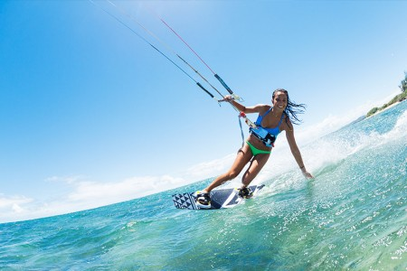 a girl kiteboarding in the ocean