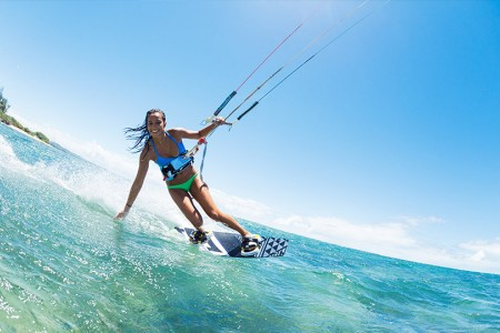a girl kiteboarding