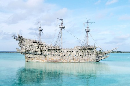 an old ship in the middle of the ocean