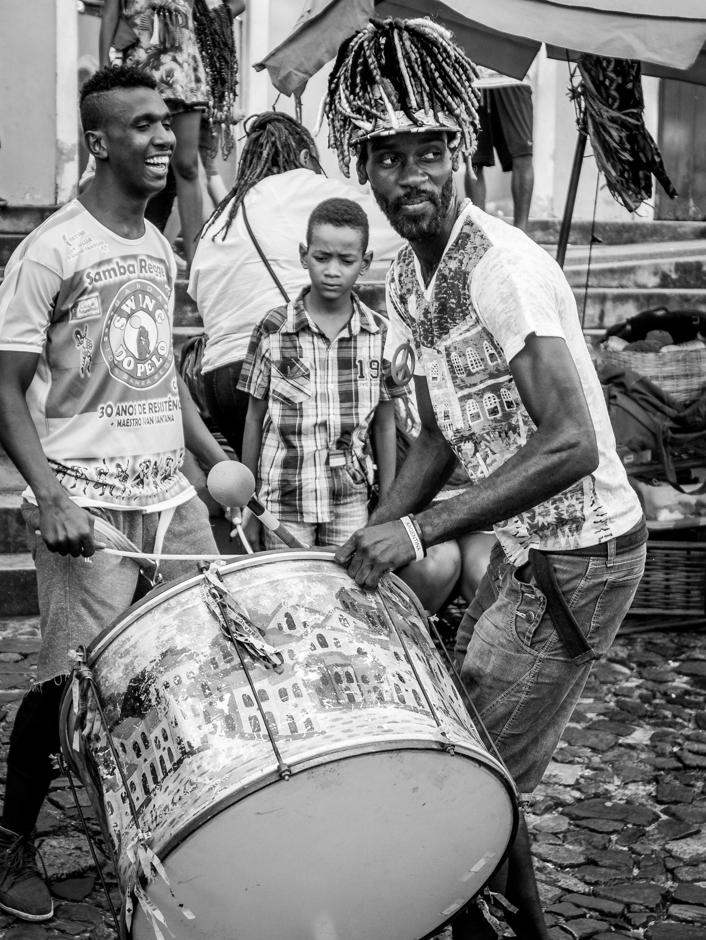 Men playing the drums black and white filter