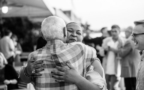 black and white image of two people hugging