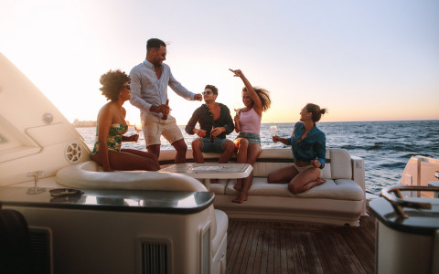 a group of friends having fun drinking wine together on a boat