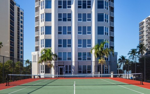 Tennis court in front of hotel building