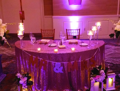 Bride & groom table with sequin tablecloth & white floral arrangements