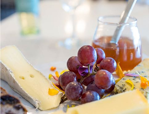 Close up of cheese with grapes
