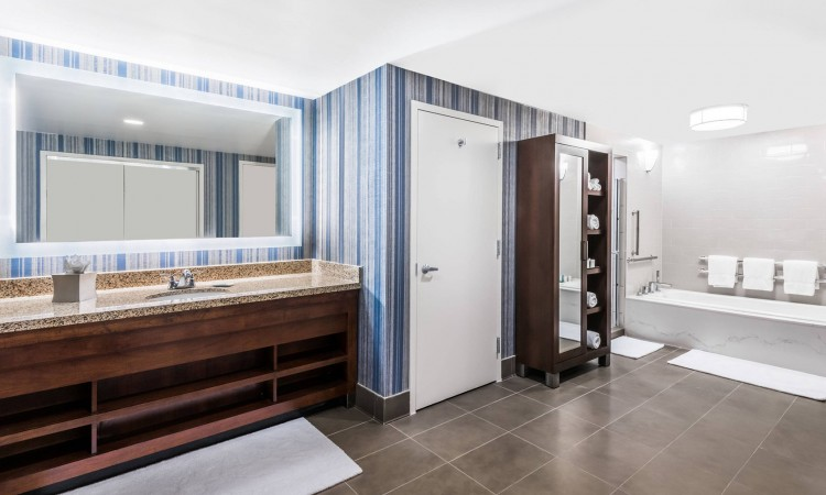 large bathroom with sink, and bathtub/ shower