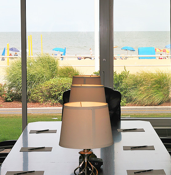 lamps in the meeting room with the beach in the background
