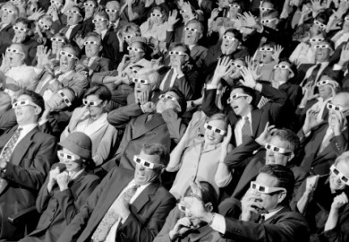 movie theater audience all wearing 3d glasses