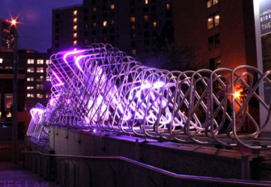 metal sculpture lit up with purple lights