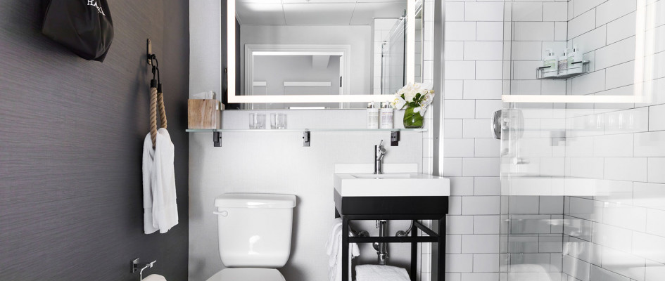 Modern bathroom with gray wall and white tile