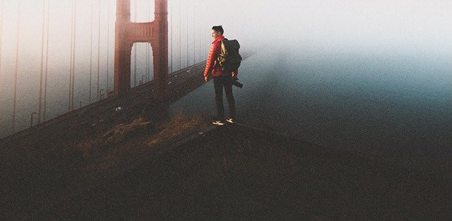 Man standing overlooking the San Francisco bridge