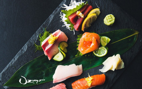 colorful sushi on a black slate surface