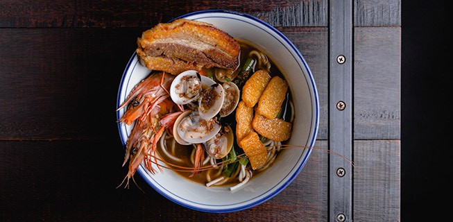 shrimp and oysters and other food in a bowl