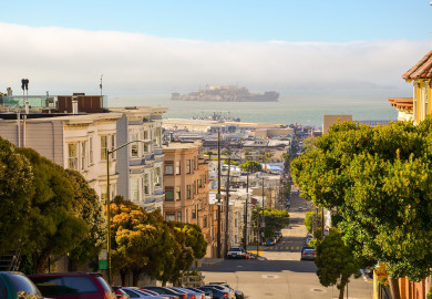 San Francisco street with Alcatraz in the distance