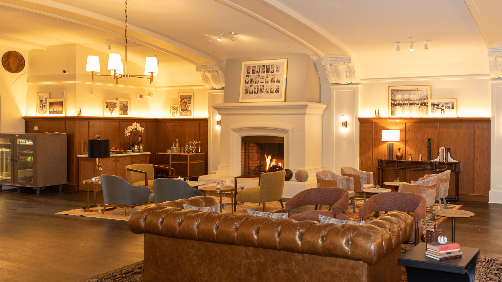 hotel lobby with large brown leather couch and fireplace
