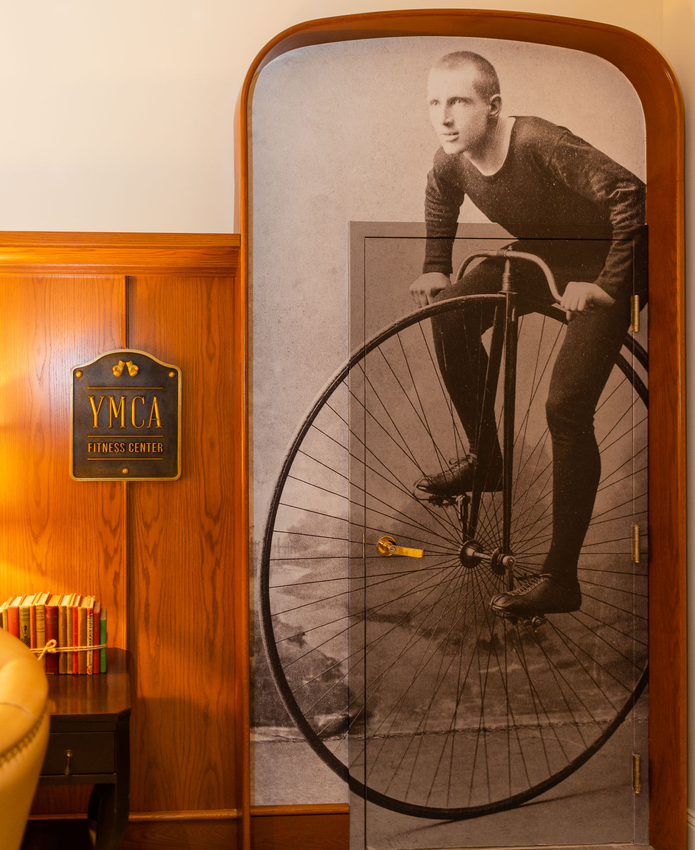framed black and white photo of man on unicycle