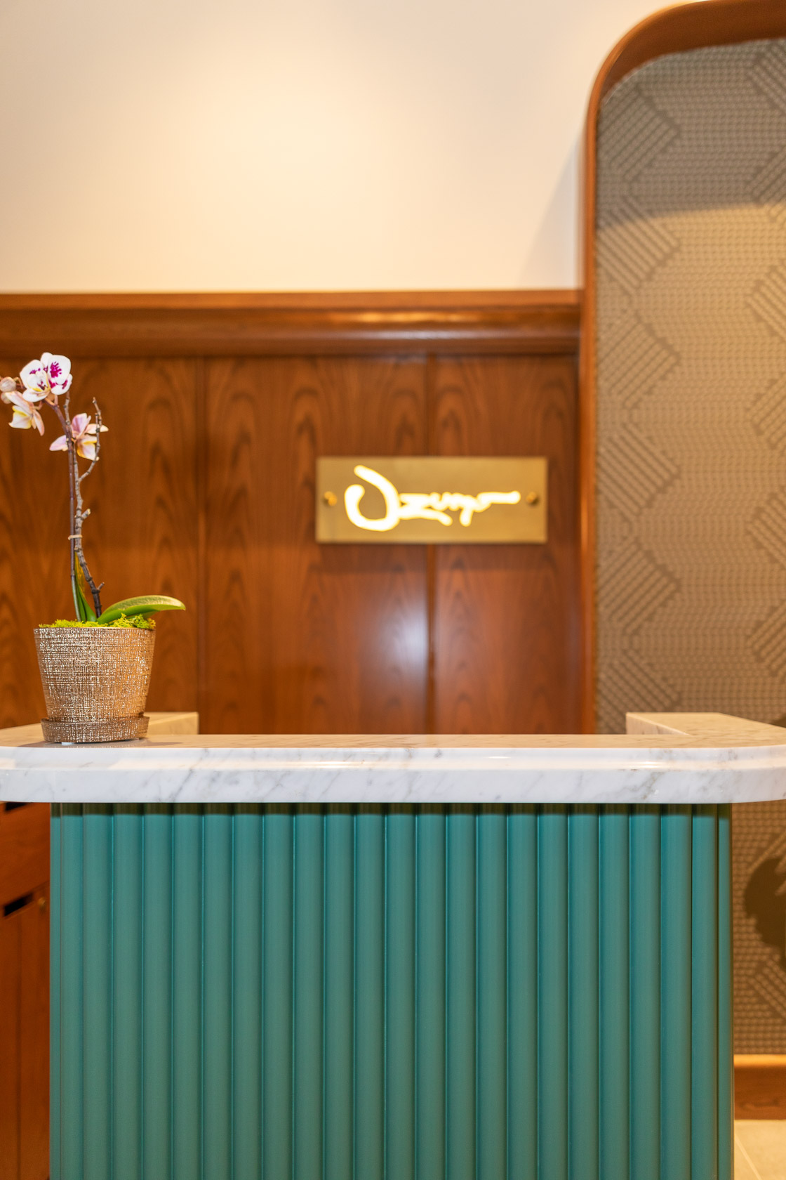 jade green lobby front desk with orchid