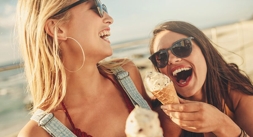 Girls eating ice cream and laughing