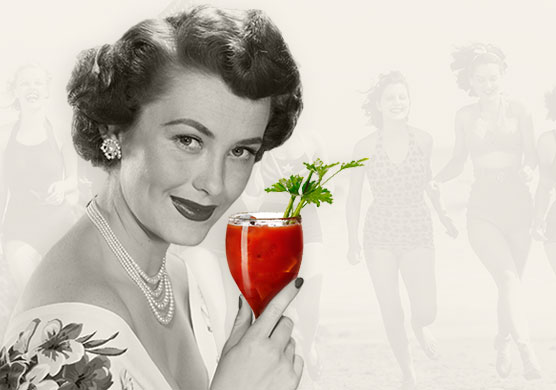 woman holding a bloody mary