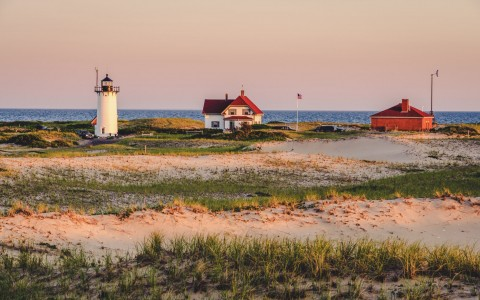 sunset beach with lighthouse