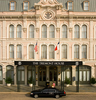 Exterior of the Tremont House hotel with a car parked at the entrance