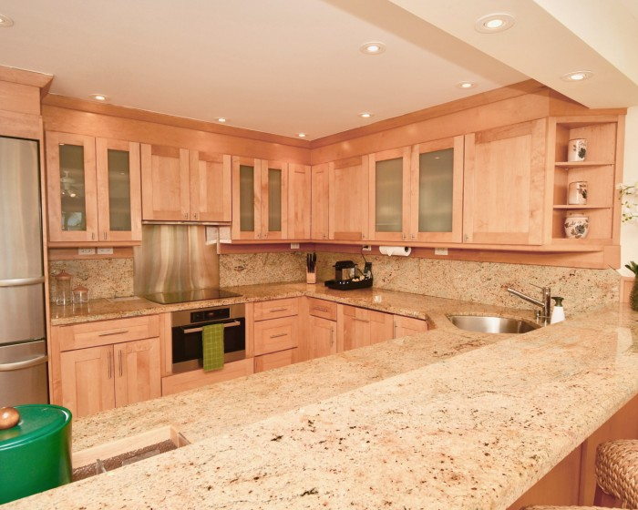 large spacious kitchen with granite countertops and wooden cabinets