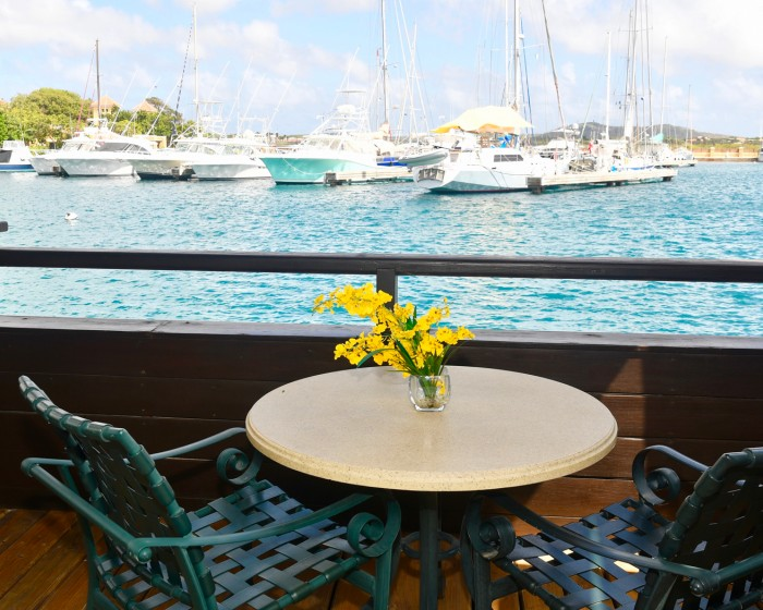 small round table in the balcony facing the marina