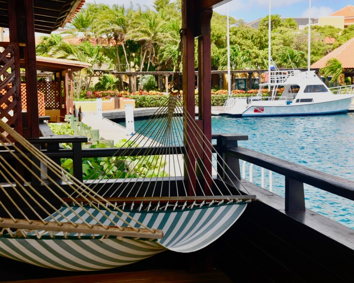 hammock facing the marina on a balcony