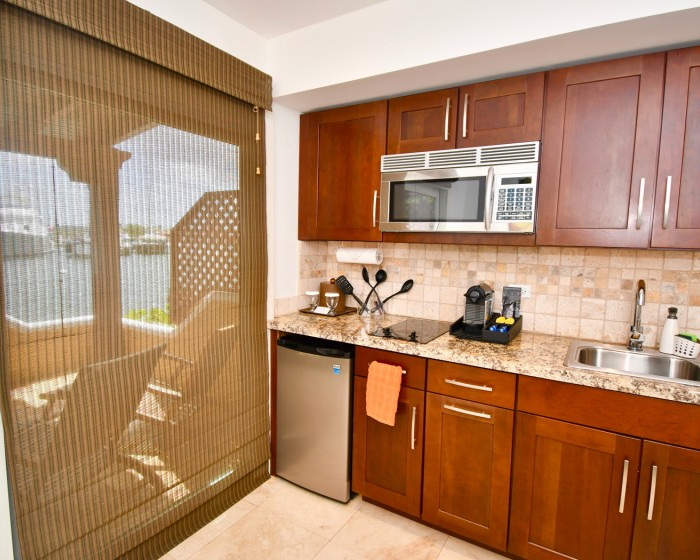 small kitchen area with sliding doors leading to balcony