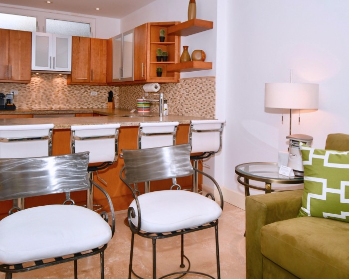 high chairs with white cushions on the kitchen bar