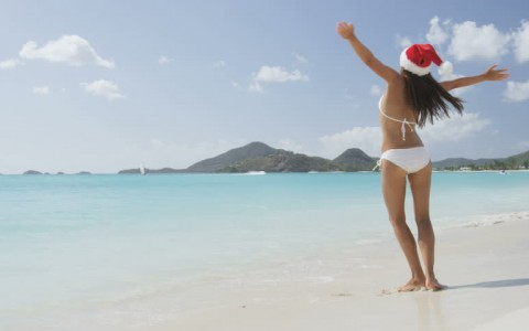 Girl in Santa Hat on Beach