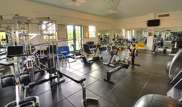 a gym with black gym floor and equipment