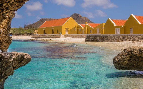 yellow huts near the water