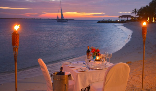 table for two on the beach in sunset
