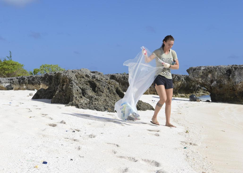 girl helping with beach cleanup
