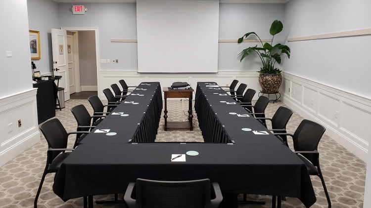 meeting room with black tables and chairs