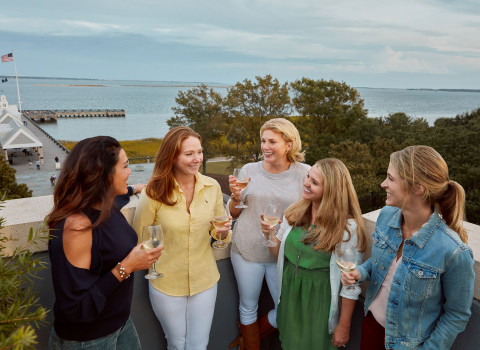 A group of women enjoying drinks at HarbourView Inns Rooftop Bar