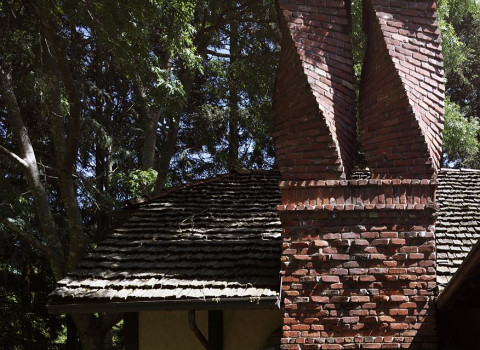 close up of the brick work of the tudor style building showing the unique chimneys