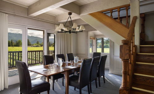 brown table and sitting room overlooking vineyard