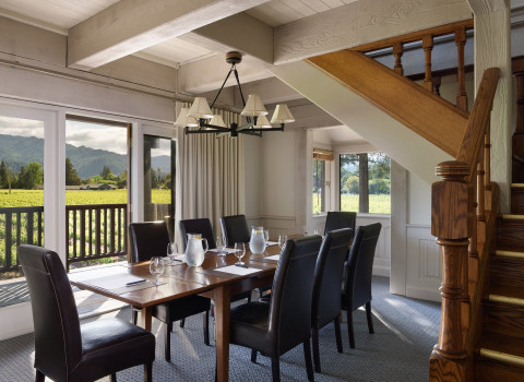 Dining area next to wooden stairs with vineyard view
