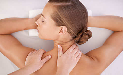 Hands massaging woman's back at the spa