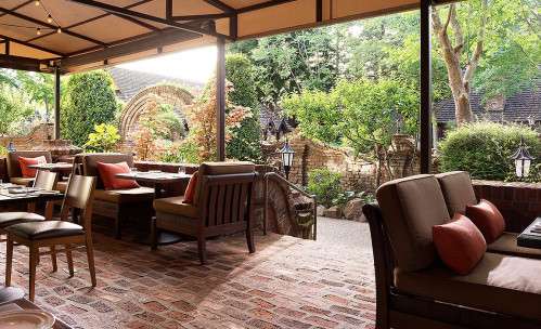 Outdoor dining with cushioned wicker seating