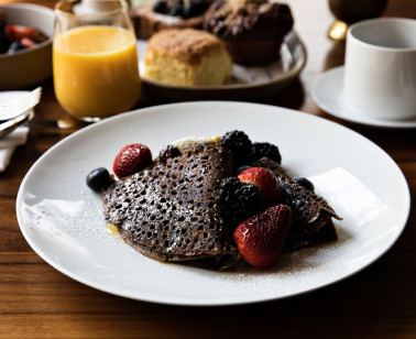 chocolate pancakes with berries and orange juice