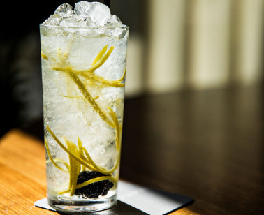 fizzy drink with thin sliced lemon rind