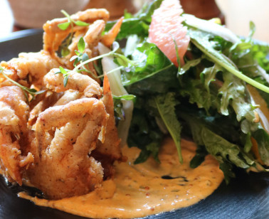 soft shell crab in cream sauce with greens