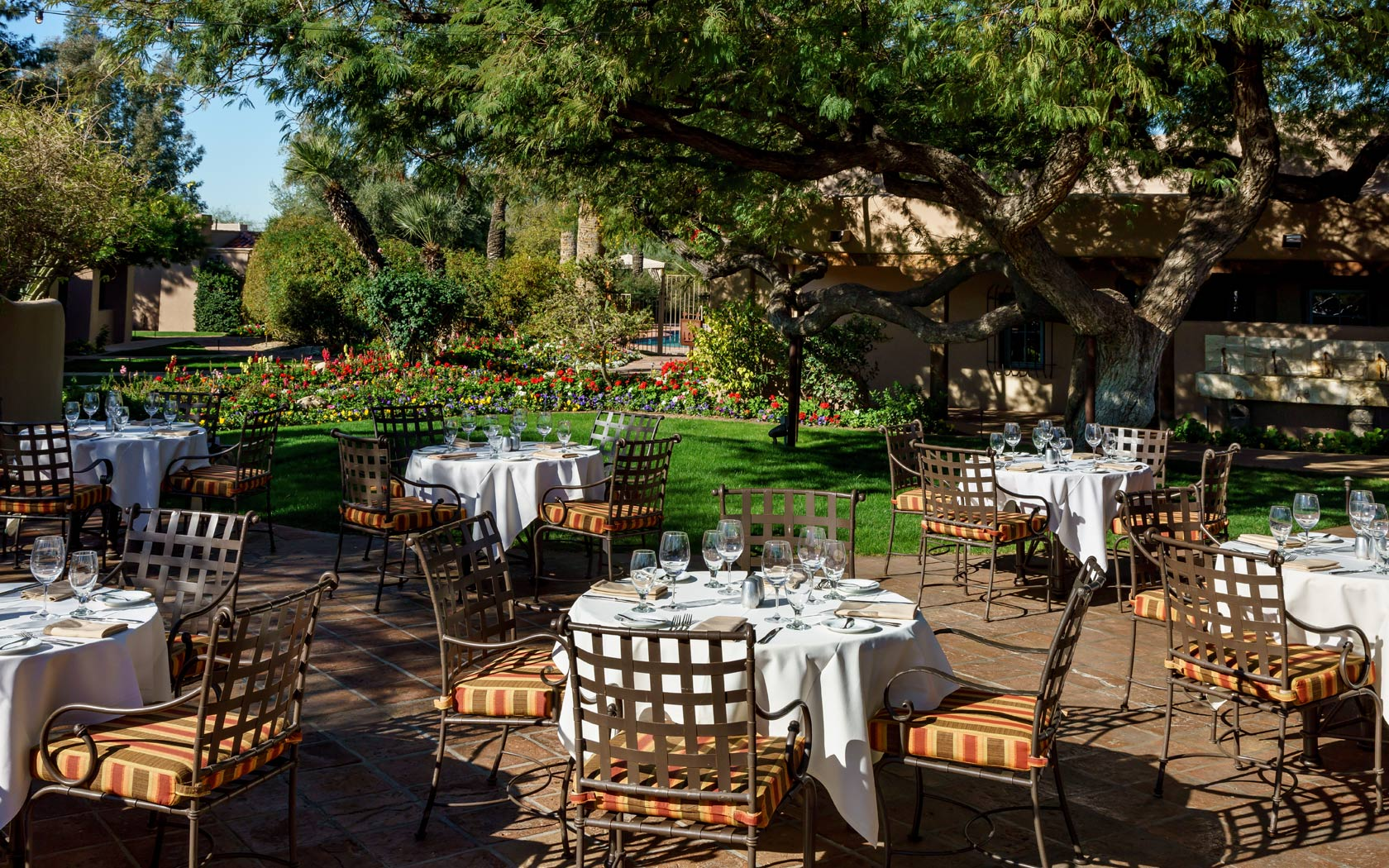 Outdoor Dining Area With Several Set Round Tables